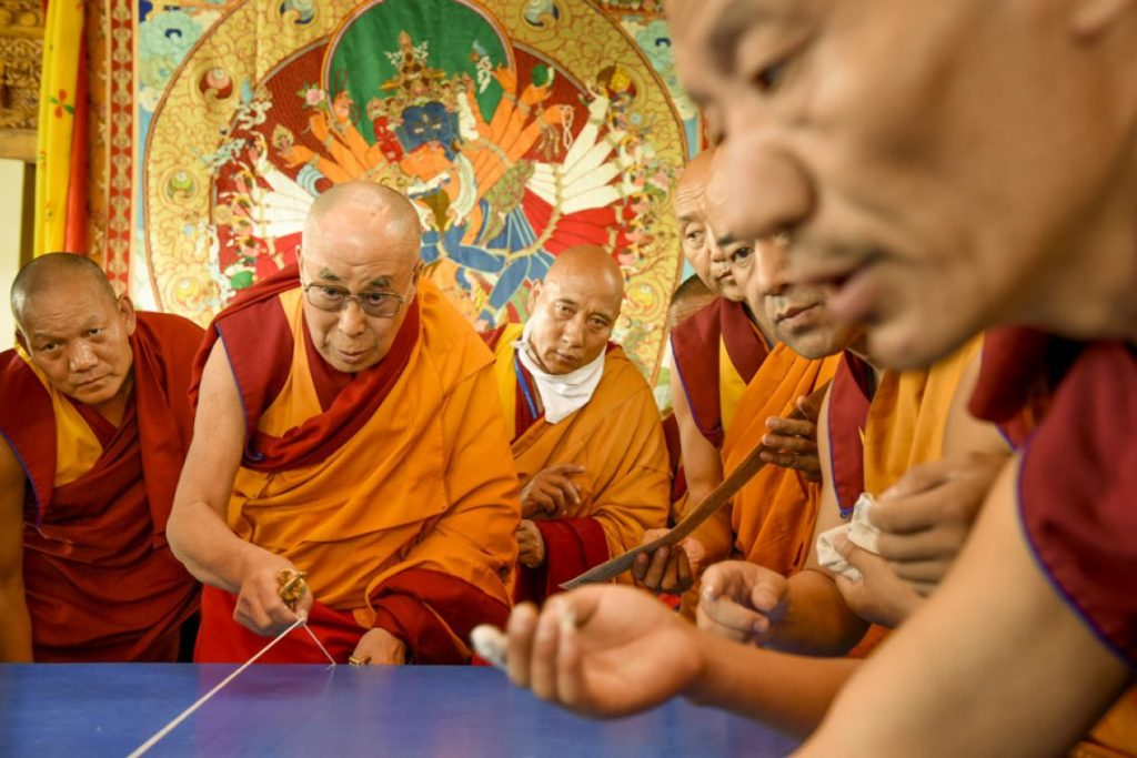 Kalachakra Study 2017 - Podcast Bonus RAFT Archives Photo of Dalai Lama creating Kalachakra Sand Mandala with Monks by Manuel Bauer, Used with permission via www.dalailama.com.